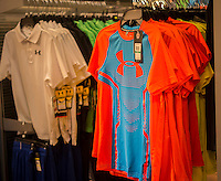 Under Armour merchandise in a sporting goods store in New York on Monday, May 4, 2015. The high-tech athletic apparel company recently reported its 20th straight quarter of revenue growth as it competes with the market leader Nike.  (© Richard B. Levine)
