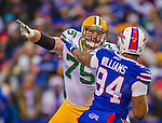 14 December 2014: Green Bay Packers tackle Bryan Bulaga blocks against Buffalo Bills defensive end Mario Williams in the third quarter at Ralph Wilson Stadium in Orchard Park, NY. The Bills defeated the Packers 21-13, snapping the Packers' 5-game winning streak and keeping the Bills' 2014 playoff hopes alive. Mandatory Credit: Ed Wolfstein Photo *** RAW (NEF) Image File Available ***
