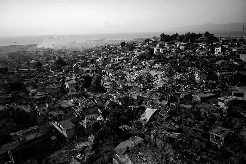 Port Au Prince, Haiti, Jan 27 2010.Seen from the sky, Port au Prince two weeks after the earthquake; a large majority of buildings are either destroyed or too damaged to be used, so most inhabitants sleep out, in the street near their home or in makeshift camps..