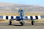 Race #12, &quot;The Rebel,&quot; a stock P-51D Mustang flown by Doug Matthews of Wellington, Florida turns the prop while on the tarmac prior to a race at the 2008 Reno National Championship Air Races at Stead Field, Nevada. Matthews, a rookie in 2008, flew the Rolls Royce Merlin powered fighter to a second place finish in the Bronze class with a speed of 350.290 MPH on the 50.12 mile course.