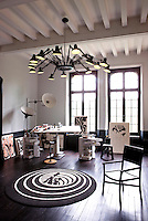 "Olivier's studio is furnished with a ""Bobby Trolley"" by Joe Colombo illuminated by a ""Dear Ingo"" pendant light by Ron Gilad"