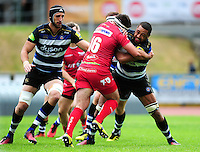 Taulupe Faletau of Bath Rugby takes on the Scarlets defence. Pre-season friendly match, between the Scarlets and Bath Rugby on August 20, 2016 at Eirias Park in Colwyn Bay, Wales. Photo by: Patrick Khachfe / Onside Images