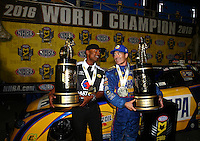 Nov 12, 2016; Pomona, CA, USA; NHRA funny car driver Ron Capps (right) and Antron Brown celebrate after clinching the 2016 funny car world championship during qualifying for the Auto Club Finals at Auto Club Raceway at Pomona. Mandatory Credit: Mark J. Rebilas-USA TODAY Sports