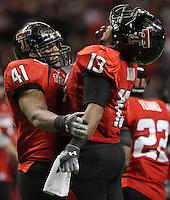 Texas Tech's Sam Fehoko, left, and Julius Howard celebrate a play during the second half of the Valero Alamo Bowl, Saturday, Jan. 2, 2010, at the Alamodome in San Antonio. Texas Tech won 41-31. (Darren Abate/pressphotointl.com)