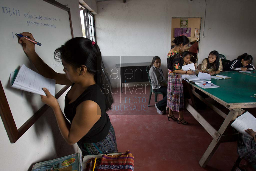 Young laborers, who work for local vegetable and fruit exporters, textile plants and private homes, study primary school subjects at the Centro de Estudios Apoyo al Desarrollo Local in Chimaltenango, Guatemala on Sunday, March 11, 2007. The workers' long hours keep them from studying much during the week.