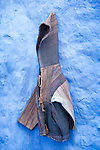 Jacket hanging on wall in the medina of Chefchaouen, Morocco.