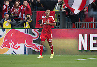 Toronto, Ontario - May 17, 2014: Toronto FC forward Luke Moore #27 celebrates after scoring a goal late in the second half during a game between the New York Red Bulls and Toronto FC at BMO Field. Toronto FC won 2-0.