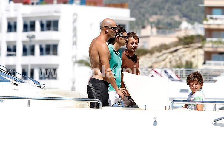 **ALL ROUND EXCLUSIVE PICTURES FROM SOLARPIX.COM**.**WORLDWIDE SYNDICATION RIGHTS EXCLUDING SPAIN - NO PUBLICATION IN SPAIN**.French footballer Zinedine Zidane on holiday with his family aboard a Yacht in Ibiza, Spain. ..This pic: Zinedine Zidane..JOB REF: 11967        JMB      DATE: 21.08.2010.**MUST CREDIT SOLARPIX.COM OR DOUBLE FEE WILL BE CHARGED**.**MUST AGREE FEE BEFORE ONLINE USAGE**.**CALL US ON: +34 952 811 768 or LOW RATE FROM UK 0844 617 7637**