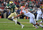 Nov. 12, 2011; Running back Cierre Wood stiff arms Maryland Terrapins linebacker Alex Twine. ..Photo by Matt Cashore/University of Notre Dame