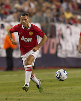 Manchester United FC midfielder Ryan Giggs (11) passes the ball. In a Herbalife World Football Challenge 2011 friendly match, Manchester United FC defeated the New England Revolution, 4-1, at Gillette Stadium on July 13, 2011.