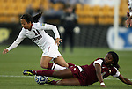 02 December 2011: Florida State's Jamia Fields (4) tackles the ball away from Stanford's Rachel Quon (11). The Stanford University Cardinal played the Florida State University Seminoles at KSU Soccer Stadium in Kennesaw, Georgia in an NCAA Division I Women's Soccer College Cup semifinal game.