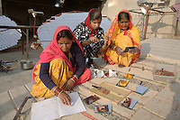 Women trained at the Barefoot College in Tilonia work on constructing large solar parabolas/cookers which focus the sun's rays onto cooking pots- rapidly bringing water or other ingredients to a boil without the need for firewood or other fuels. All the parts are locally available such as mirrors and bicycle gears adapted to turn the cooker on an axis tracking the sun's movement during the day. Solar cookers made by the college are being set up in remote rural villages and are maintained by local women...