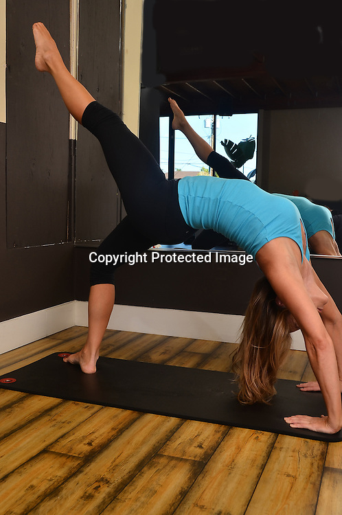 stock photo of woman at yoga studio