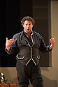 London, UK. 14.10.2014. English National Opera presents THE MARRIAGE OF FIGARO, directed by Fiona Shaw, at the London Coliseum. Picture shows: David Stout (Figaro).  Photograph © Jane Hobson.