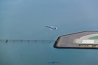 aerial photograph of jet takeoff San Francisco International airport SFO over bay