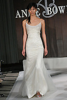 Model walks runway in a Metropolitan wedding dress by Anne Bowen, for the Anne Bowen Bridal Spring 2012 runway show.