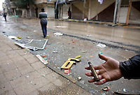 A person holds an empty gun cartridge found on the street of the eastern Damascus suburb of Sakba after an assault by government forces in their attempt to retake teh area from the Free Syria Army. Protests against the ruling Baathist regime of Bashar al-Assad erupted in March 2011. Although they were initially peaceful,  they were violently repressed by the Syrian army and police. In response to being ordered to shoot unarmed civilians, large numbers of men deserted the army and formed the Free Syrian Army. The protest movement has now turned into an armed uprising with clashes between the regular army and the Free Syrian Army taking place in early 2012...