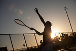 Los Altos High School tennis player, Jehan Godrej serves the ball on the tennis court.