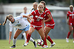 16 September 2016: NC State's Paige Griffiths (21) spins away from North Carolina's Sarah Ashley Firstenberg (54). The University of North Carolina Tar Heels hosted the North Carolina State University Wolfpack in a 2016 NCAA Division I Women's Soccer match. NC State won the game 1-0.