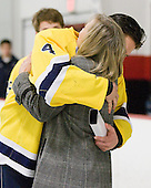 Mike Switzer (Bentley - 4) gives his mom a hug. - The Bentley University Falcons tied the visiting College of the Holy Cross Crusaders 2-2 on Bentley senior night on Friday, February 24, 2012, at the John A. Ryan Skating Arena in Watertown, Massachusetts.