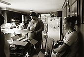 Garrett, Pennsylvania.July 7, 2003..Randy Fogle and his daughter Brittany in the kitchen of their home in Garrett look through a box of letters sent by well-wishers ..