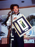 """Sunny Garcia (HAW)  with the 1990 ASP """"Most Improved"""" award at the ASP Awards banquet  in Hawaii. Photo: joliphotos.com"""