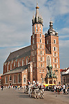 A horse carriage in front of St. Mary's Basilica in Krakow, Poland. St. Mary's Basilica sits on the Main Market Square, and was first built in the 13th century