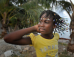 """Kerline Jean Louis, a member of Nouvel Etwal - Haitian Kreyol for """"New Stars"""" - dances on the beach at Jacmel, Haiti. Nouvel Etwal is a dance and creative movement group of 16 girls from age 8 to 13, based in the southern village of Mizak. According to Valerie Mossman-Celestin, an organizer of the group, """"Nouvel Etwal seeks to empowers girls to be self-confident and creative. The girls learn flexibility, discipline and teamwork, lessons they also need for life. Nouvel Etwal promotes health, well-being and enhanced self-worth. The girls are encouraged to live into a brighter future where girls and women are valued,  educated, and have equal opportunity to achieve their potential."""""""
