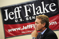 Apache Junction, Arizona. October 19, 2012 - Arizona Congressman Jeff Flake listens to retiring Senator Jon Kyl as he speaks in Flake's favor during a town hall at the Mountain View Lutheran Church in Apache Junction, Arizona. Flake is running for the senate seat Kyl is leaving as he retires. Photo by Eduardo Barraza © 2012