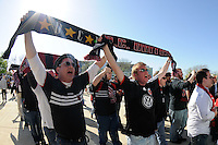 D. C. United supporters march over to Lincoln Financial Field prior to the game. The Philadelphia Union defeated D. C. United 3-2 during a Major League Soccer (MLS) match at Lincoln Financial Field in Philadelphia, PA, on April 10, 2010.