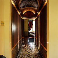 This narrow corridor has been transformed with an Etruscan mural and an elaborate painted ceiling