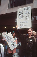 Activists protest Monsanto's use of Bovine Growth Hormone (rBGH) in New York on March 24, 1994 when Monsanto initially started marketing it. The company announced that it would attempt to sell off it's artificial growth hormone for dairy cow business, branded Posilac. A number of larger retailers, such as Wal-Mart and Kroger, sell house brand milk from untreated cows. (© Richard B. Levine)