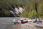 Gordon Congdon and Robbie Scott unload their canoe.  Gataga River, British Columbia.  Muskwa-Kechika Management Area.