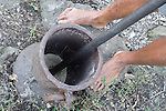 Vuna Village, Taveuni, Fiji; dried kava root is pounded into a powder, so that it may be strained in water and drank