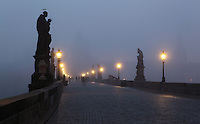 Dawn at the Charles Bridge or Karluv most, built 1357 - 15th century, across the Vltava river in Prague, Czech Republic. Its construction began under King Charles IV, replacing the old Judith Bridge built 1158'??1172 after flood damage in 1342. This new bridge was originally called the Stone Bridge (Kamenny most) or the Prague Bridge (Prazsky most) but has been the Charles Bridge since 1870. The bridge is 621m long and nearly 10m wide, resting on 16 arches shielded by ice guards. It is protected by three bridge towers, two on the Lesser Quarter side and one on the Old Town side. The historic centre of Prague was declared a UNESCO World Heritage Site in 1992. Picture by Manuel Cohen