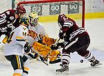 23 January 2009: University of Vermont Catamount goaltender Rob Madore, a Freshman from Venetia, PA, makes a third period save against the University of Massachusetts Minutemen during the first game of a weekend series at Gutterson Fieldhouse in Burlington, Vermont. The Catamounts defeated the visiting Minutemen 2-1. Mandatory Photo Credit: Ed Wolfstein Photo