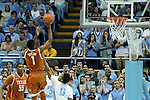 18 December 2013: Texas' Isaiah Taylor (1) takes a jump shot over North Carolina's Nate Britt (0). The University of North Carolina Tar Heels played the University of Texas Longhorns at the Dean E. Smith Center in Chapel Hill, North Carolina in a 2013-14 NCAA Division I Men's Basketball game. Texas won the game 86-83.
