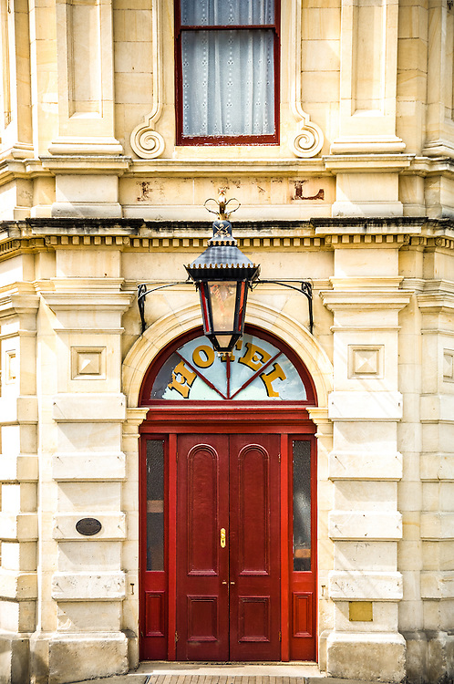 Red door, Historic Whitestone Hotel, Oamaru, New Zealand - stock photo, canvas, fine art print