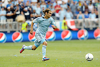 Kansas City midfielder Graham Zusi takes the ball into the San Jose half... Sporting Kansas City defeated San Jose Earthquakes 2-1 at LIVESTRONG Sporting Park, Kansas City, Kansas.