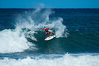 North Shore, Oahu, HAWAII - (Sunday, Nov. 24, 2013) Fred Patacchia (HAW). -- Tahiti's Michel Bourez (PYF) has won the REEF Hawaiian Pro, the $40,000 prize purse, and takes an early lead of the Vans Triple Crown of Surfing hydrated by vitaminwater&reg;. Bourez, 27, built momentum through the earlier rounds of this competition and was clearly unstoppable by the final. He survived a late charge by Haleiwa local Fred Patacchia, 31, and was well clear of Jeremy Flores (France) and Dion Atkinson (Australia), who finished third and fourth respectively.<br /> This is Bourez's second victory at the REEF Hawaiian Pro, having first won here in 2008. His combination of stylish power surfing and impeccable wave selection made him the man to beat through the final rounds of competition today. A strong surfer in big waves and a great Tahitian tube rider, he is definitely capable of winning the Vans Triple Crown this year.<br /> The most relieved athlete today was Dion Atkinson, 27, from South Australia. Atkinson entered the REEF Hawaiian Pro with work to be done if he is to qualify for the 2014 elite ASP World Championship Tour. With this result, he climbed into qualification position today, has taken off a little pressure going into Sunset, and will now be looking to maintain form in order to make his pro surfing dreams come true.  Photo: joliphotos.com