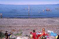 "People sunbathing on the Beach and swimming in the Pacific Ocean at Qualicum Beach, in the ""Oceanside Region"" of Vancouver Island, British Columbia, Canada"