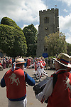 East Kent Morris Men. Dancing in the square outside the church of St Peter and St Paul Charing Kent UK. Spring Bank Holiday Monday.