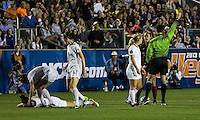Number one seeds Virginia Tech and Florida State play in the the NCAA Division I Soccer Tournament semifinals at Wakemed Soccer Park in Cary, NC on December 6, 2013.  Taylor Antolino (17) receives a yellow card.
