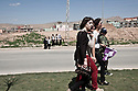 Iraq - Kurdistan - Dohuk - muslim girls (background) looking at Christians celebrating the Assyrian New year