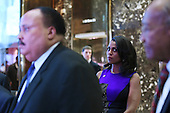 Omarosa Manigault (second from right) looks as Martin Luther King III (l) speaks to members of the media after a meeting with President-Elect Donald J. Trump (not pictured) in the lobby of the Trump Tower in New York, NY, on January 16, 2017.<br /> Credit: Anthony Behar / Pool via CNP