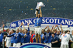 Ronald de Boer leads the party celebrations as Rangers win the SPL on goal difference from Celtic