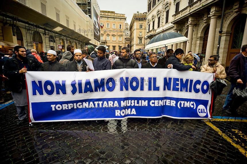 Roma 21 Novembre 2015<br /> Manifestazione promossa dall&rsquo;Unione delle comunit&agrave; islamiche italiane &laquo;Not in my Name&raquo;  per dire no al terrorismo e contro Isis ( Stato Islamico). Sul cartello si legge: Non siamo noi il nemico<br /> Rome November 21, 2015<br /> Demostration sponsored by the Union of Italian Islamic Communities &quot; Not in My Name&quot; to say no to terrorism and against Isis (Islamic State). The sign reads: We are not the enemy