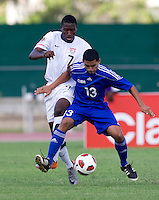 Alfred Karoma (7) of the United States tries to take the ball away from Sajay Herrera (13) of Cuba during the first day of the group stage at the CONCACAF Men's Under 17 Championship at Catherine Hall Stadium in Montego Bay, Jamaica. The United States defeated Cuba, 3-1.