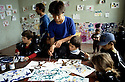 France 1989.Enfants kurdes irakiens dans un atelier de peinture au camp militaire de Lastic.France 1989.Kurdish Iraqi children painting in the military camp of Lastic