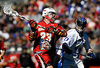 Tom Montelli (11) of Duke closes in on Will Yeatman (23) of Maryland as he shoots during the Face-Off Classic in at M&T Stadium in Baltimore, MD